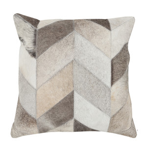 As Shown: Hair-on Herringbone Pillow Size: 18 x 18 inches Material: Hair-On Cowhide  Description: Rich blocks of beige, light grey, ivory and taupe, impart your style with elegant texture. By hand artisans seam pieces of hair-on cowhide then back in fabric with a feather and down inner. Each pillow is individual to you, please allow for variation in color and markings. A lovely combination with our Prism Cowhide Pillow, we love their understated chic and soft coziness in sleek modern interiors or rough organic spaces.