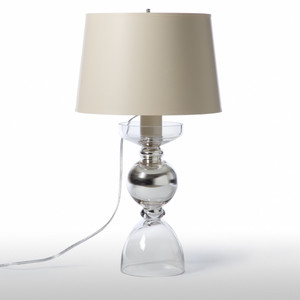 As Shown: Bergman Table Lamp Size: 13 diameter x 22 H inches Material: Mouth-Blown Glass with Interior Silver Glaze Shade: Painted Parchment  Description: Freshness and vitality for your living or bedroom table. The seductive curves of this mouth-blown glass and silver metal lamp support a deceptively simple painted parchment empire shade.