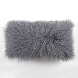 As Shown: City Grey Mongolian Lamb Pillow Size: 10 x 18 inches Description: You'll love to cozy up with this medium grey Tibetan fur pillow. Its classic hue injects lush texture and depth when tossed in with colorful fabric pillows. By hand, artisans craft these premium designer-quality lambskin cushions. Backed in matching fabric with a feather and down inner, your pillow will be individually created for you.