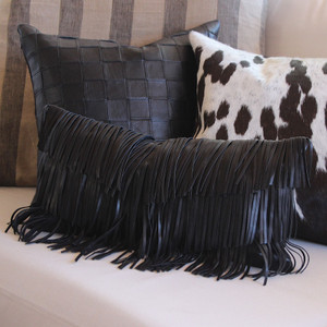 As Shown: Flamenco Fringe Pillow Size: 9 x 18 inches Material: Leather Color: Black Description: Get moving with three finely trimmed layers of overlapping leather fringe tapering into a central V. Artisans piece and hand-trim fringe front, then back in matching leather. Fitted with a feather and down inner and hidden zipper, your pillow will be individually created for you. Run the gamut from flamenco hot to festival cool depending on your leather color choice.