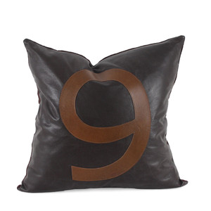 As Shown: Lucky Number Pillow Size: 18 x 18 inches Material: Leather Color: Espresso Brown with Chocolate Brown Number  Description: Rock your lucky number with these fun, graphic leather pillows. By hand, artisans cut and attach the letter to the leather surface below with a topstitch outline, then back with matching linen or leather. Fitted with a feather and down inner, your pillow will be individually created for you. Display a special date, year, address, area code – your possibilities are infinite.