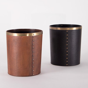 As Shown: Lucca Leather Waste Bin Size: 10.5 dia x 12 H inches Material: Leather and Brass Color: Antique Brown and Black