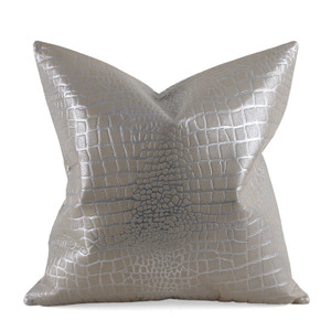 As Shown: Palm Springs Pillow Size: 16 x 16 inches Material: Leather Color: Silver Description: Tonal elegance softens rugged croc with chic metallic embossing. By hand artisans emboss a crocodile pattern onto leather with a thin silver foil in between then back in matching linen or leather. Fitted with a feather and down inner, your pillow will be individually created for you. A subdued way to impart a bold texture into your décor.