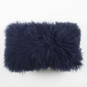 As Shown: In The Navy Mongolian Lamb Pillow Size: 10 x 18 inches Description: You'll love to cozy up with this classic navy Tibetan fur pillow. Its saturated hue injects lush texture when tossed in with colorful fabric pillows. By hand, artisans craft these premium designer-quality lambskin cushions. Backed in matching fabric with a feather and down inner, your pillow will be individually created for you.