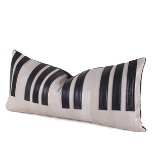 As Shown: Tickle The Ivories Pillow Size: 9 x 20 inches Material: Leather Color: Bone and Black  Description: Make beautiful music with this fun leather piano keys pillow. By hand, artisans cut and outline each piece with a topstitch then back with black linen or leather. Fitted with a feather and down inner, your pillow will be individually created for you. In a narrow lumbar size, it strikes the perfect note when nestled in the back of your favorite musician's chair.