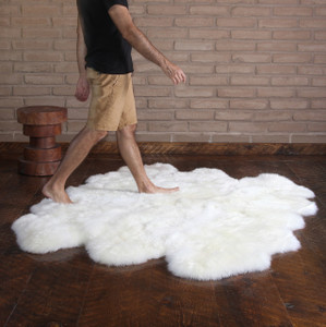 As Shown: Genuine Sheepskin Rug Size: 72 x 72 inches Material: Brushed Longwool Sheepskin    Description: Luxury, thy name is rug. New Zealand brushed longwool sheepskin rug that is. Add a swath of inviting warmth to your floor in multiple colors and sizes. Each is unique, please allow for variation. Perfect for bedside, fireside or couch side.