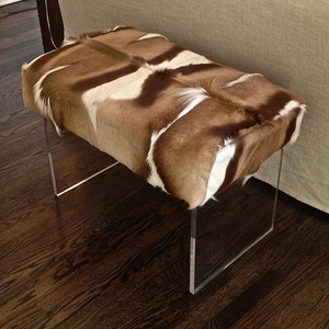 As Shown: Great Migration Antelope Bench Size: 35 x 20 x 18 H inches Material: African Springbok Hide on Acrylic Base