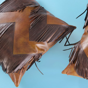 As Shown: Rodeo Fringe Pillow Size: 18 x 18 inches Material: Leather Color: Saddle Brown with Chocolate Brown Fringe