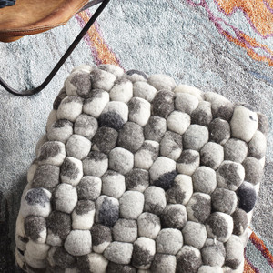 As Shown: Skipping Stones Pouf Size: 18 x 18 x 14 H inches Material: Wool Felt