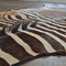 As Shown: Genuine Burchell Zebra Hide Rug Size: 11 to 15 sq ft (each is unique, please allow for variation) Material: Zebra Hide with Felt Back