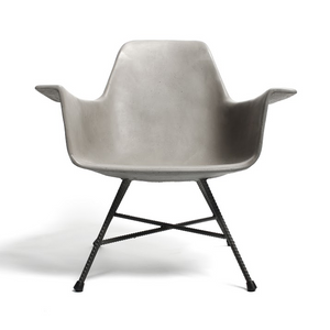 As Shown: D'Hauteville Armchair Size: 25.5 x 23.25 x 25.5 H inches (12.5 inch seat height) Material: Concrete, Iron Legs  Description: Stripped to the bare essentials a mid-century design gets a modern twist. Its ergonomic seat tops rebar-textured oxidized iron legs for brutalist minimalism. Created by Henri Lavallard Boget and made by hand, concrete is blended with sand and fiberglass to create a lightweight and durable material. Finished with a waterproof sealer, it is suitable for interior or exterior use.