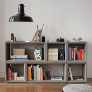 As Shown: Plus Concrete Shelves Size: 14.75 x 14.25 x 14.75 H inches or 29.5 x 14.25 x 14.75 H inches Material: Concrete  Description: Raised mitered panels and recesses add refinement to pieces made for positive expansion. Configure them in multiple combinations for infinite uses. Made by hand, concrete is blended with sand and fiberglass to create a lightweight and durable material. Finished with a waterproof sealer, it is suitable for interior or exterior use.