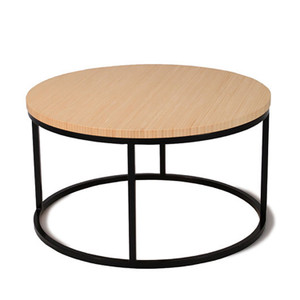 As Shown: Nimbus Bamboo Round Coffee Table Size: 24 dia x 13.5 H inches Material: Sustainable Bamboo, Powdercoated Steel Finish: Natural, Black  Description: The circular, bamboo coffee table combines the strength and beauty of fast-growing bamboo (choose from four colors) and the precision of powdered coated steel framing in black or white. Handmade to order in the USA of sustainable Moso bamboo, this eco-friendly table fits your contemporary lifestyle.