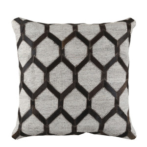 As Shown: Cowhide Pillow - MOD-002 Size: 18 x 18 inches Material: Hair-On Cowhide  Description: Bold and beautiful, hair-on cowhide strips form a stitched honeycomb trellis across this pillow. Handmade in India and including a removable inner filled with feather and down, the Trellis Hide Pillow accents your modern chair or sophisticated sofa.