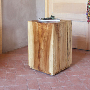 As Shown: Corrales Cottonwood Cube Size: 12 x 12 x 21 H inches Finish: Natural Topcoat: Interior  Description: Go with the grain: gorgeous graining, tonal colorations, and cracks that are inherent to the wood are offset by a satiny finish. From airy loft to wide-open ranch, this rugged beauty will keep your organic style in line. Rough-cut solid cottonwood logs are harvested from the bosque (woodlands) along the Rio Grande River in New Mexico. They are hand-shaped then dried in a solar kiln before being topped with a protective clear coat. A portion from the sale of each table goes toTree New Mexico, a non-profit dedicated toensuring sustainable forests in urban and rural communities and natural areas through restoration, public education and advocacy.