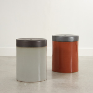 As Shown: Prisma Glazed Ceramic Stool Size: 13 x 13 x 18 H inches Material: Ceramic in Light Grey and Burnt Orange