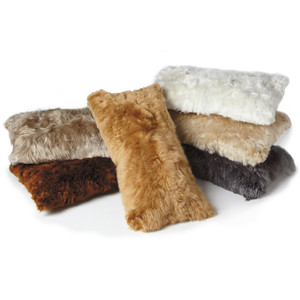 As Shown: Genuine Alpaca Hide Pillows Size: 11 x 22 inches Material: Alpaca Wool  Description: Luxuriate in fluffy-soft genuine Alpaca hide with our perfectly sized lumbar pillow. Each is individually handcrafted in South America in glorious tones to suit your style and comfort needs.