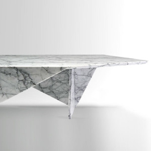 As Shown: Coprimacchia Cocktail Table Size: 61.5 x 27 x 14 H inches Material: White Uliano Marble