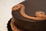 "Double Belgian Mousse Cake, 8"" serves 10."