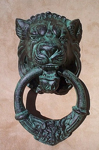 Elegant lion head door knocker in verdigris cast iron