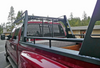 Wildcatter Super Heavy Duty Truck Ladder Rack in black powder coat with standard mesh cab guard, allowing it to carry 2,200 lbs. of evenly distributed loads. Photo credit to Bill Westphall. Toolbox NOT included.