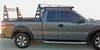 Wildcatter Super Heavy Duty Truck Ladder Rack in black powder coat  with standard mesh cab guard.