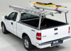 Galleon Aluminum Overhead Stake Pocket Truck Ladder Rack shown mounted without a tonneau cover and carrying cargo (ladder and canoe NOT included) - Standard Model