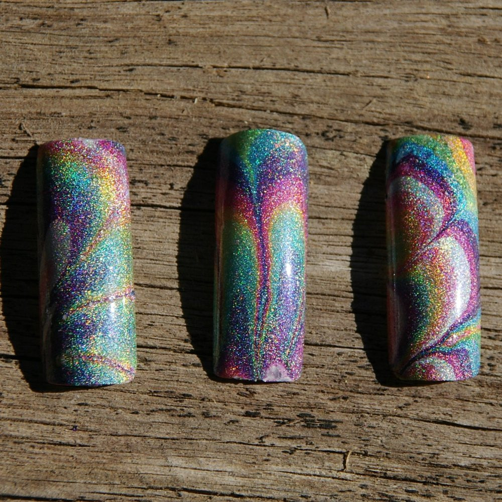Watermarble using holo stamping polishes from Hit the Bottle, available at www.lanternandwren.com.