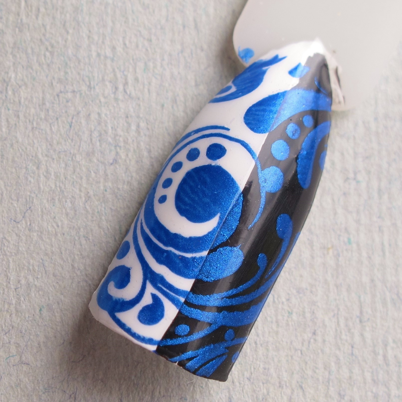 A Bolt From the Blue Stamping Polish by Hit the Bottle, get it in the USA at www.lanternandwren.com