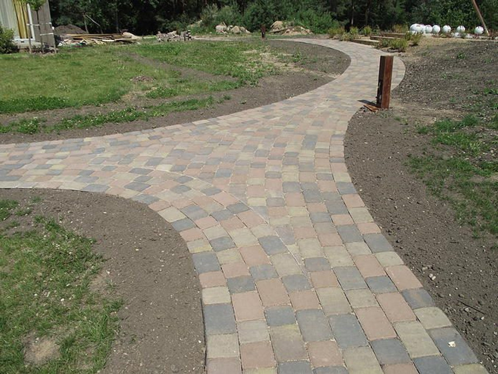 No-dig solution to keeping brick paving in place.