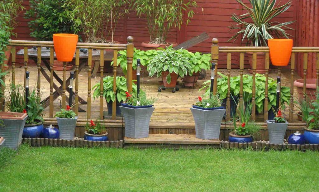 Greenbo railing planters on garden fencing.