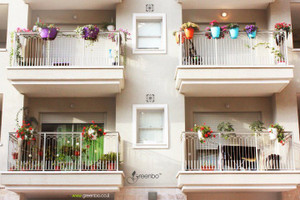 Greenbo large railing planter on balconies.