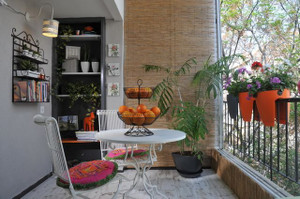 Indoor view of Greenbo orange railing planters.