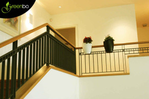 Greenbo railing planters on indoor stair railing.