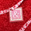 """Cupid and Arrows Ribbon in red on 5/8"""" light pink single face satin, 10 Yards"""