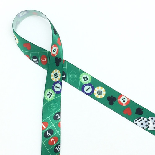 "Casino ribbon in 5/8"" width featuring tossed spades, diamonds, hearts and clubs along with dice and chips."
