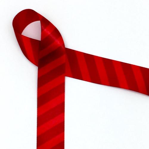 "Tone on tone stripe on 7/8"" red single face satin ribbon in 10 yard spools."