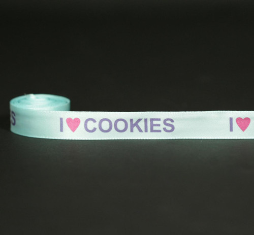 """I (heart) Cookies in purple with a pink heart with a light blue background on 5/8"""" white single face satin ribbon, 10 yards"""