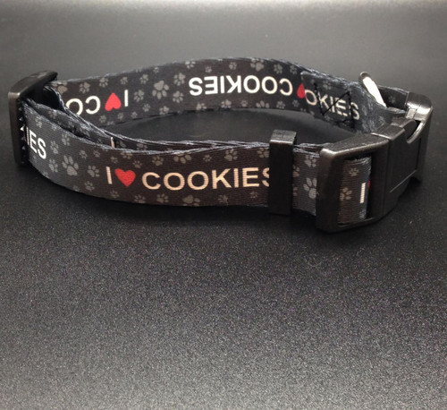 I (heart) Cookies collar with paw print cookies in gray on a black background will be a handsome addition you your pet's wardrobe!