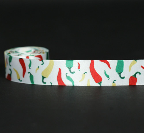 "Chili peppers in green, yellow and red on 7/8"" white single face satin ribbon on 10 yard spools."