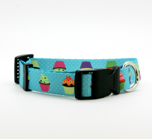 """Our 1"""" wide cupcake dog collar is just the sweetest little addition to your pet's wardrobe! These fun cupcakes are decorated with colorful frostings and sprinkles on a turquoise polkadot background! Designed and printed in the USA"""