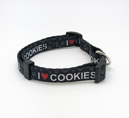 """Doesn't every dog love cookies? This adorable collar in 5/8"""" wide webbing with I (heart) Cookies and paw prints is perfect for a medium to small dog. Be sure your pup sports the height of fashion with our fun collar!"""