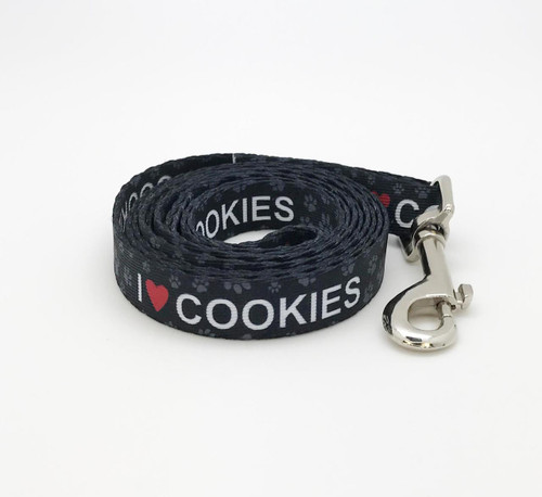 """Our I (heart) Cookies leash with paw prints in white on 5/8"""" wide webbing is the perfect expression of your pet's opinion of his favorite treats! Designed printed and assembled in the USA"""