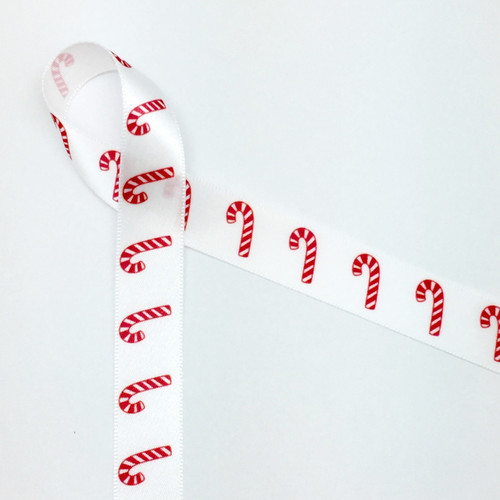 "Red and white candy canes line up along our 5/8"" wide white single face satin ribbon for a simple Holiday ribbon with a strong statement of fun!"