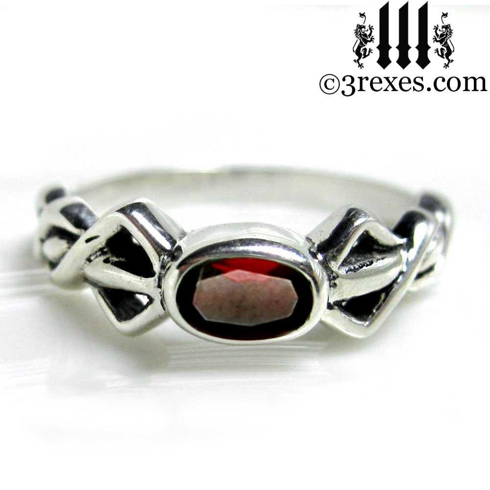 silver friendship ring with garnet stone