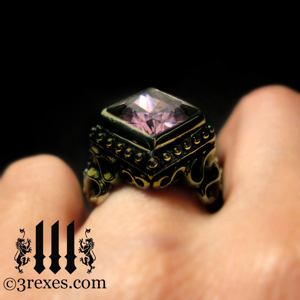 raven love brass wedding ring with large pink cz stone
