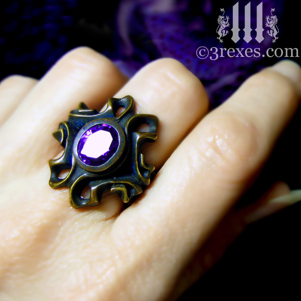 empress vampire brass ring with japanese amethyst on middle finger