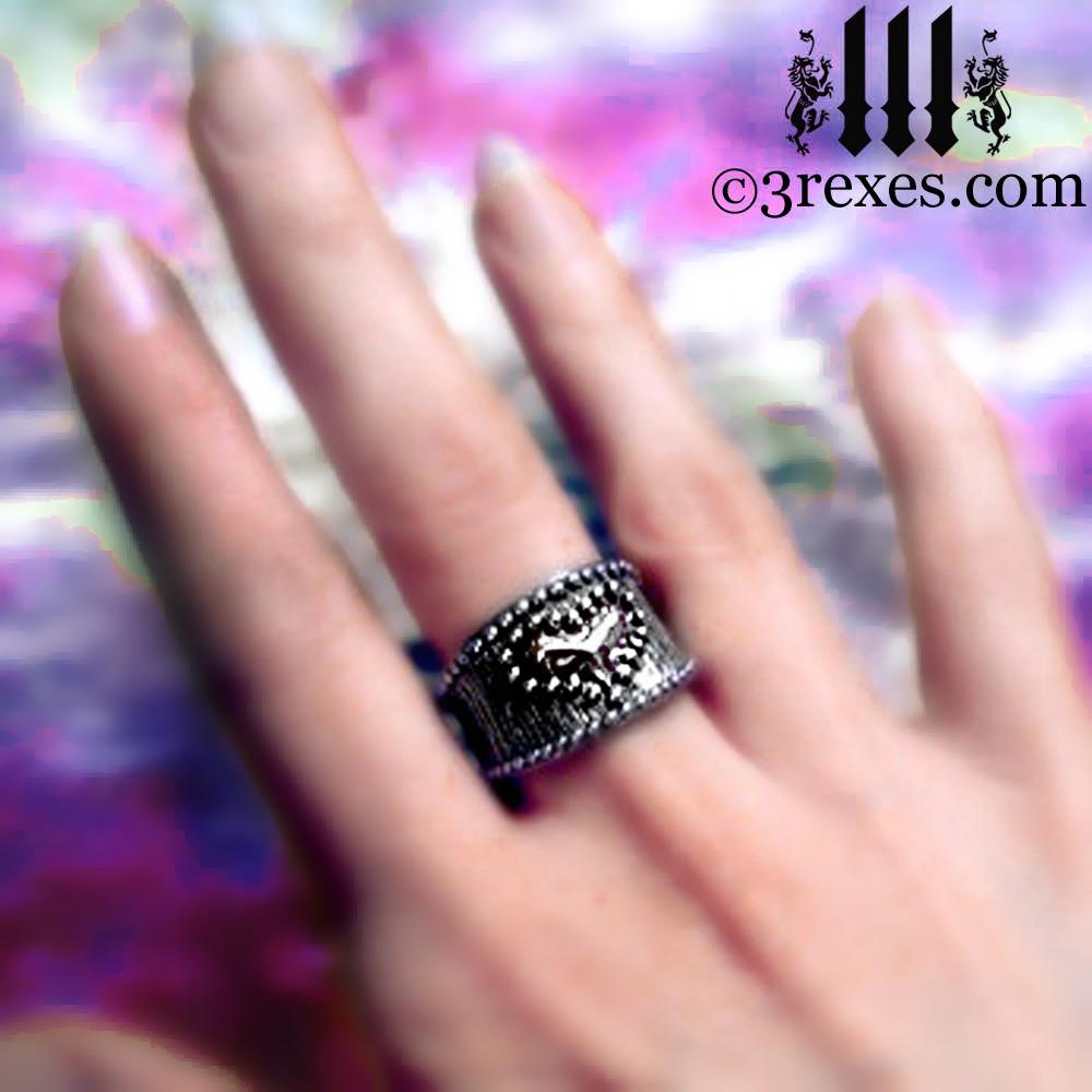 medieval studded heart ring on middle finger