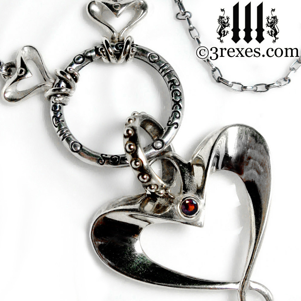 .925 silver fairy tale heart necklace with garnet stones