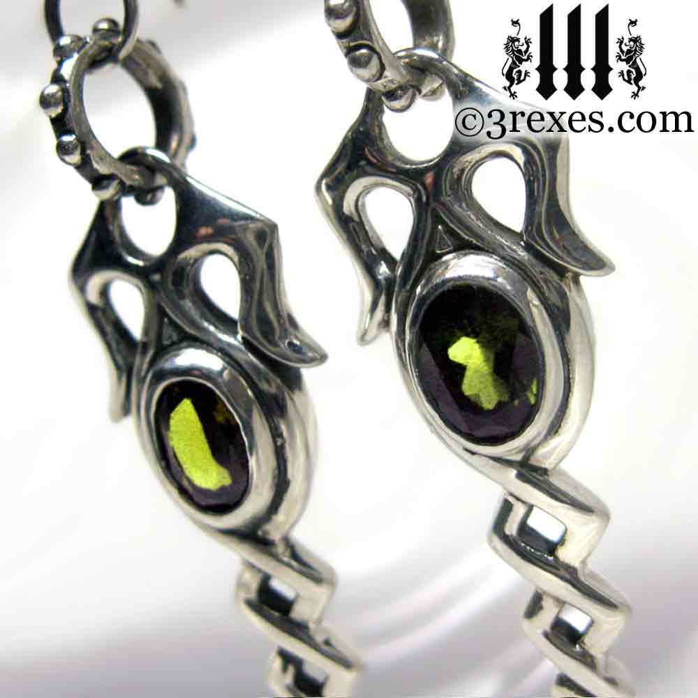 .925 sterling silver dripping celtic earrings with green peridot detail